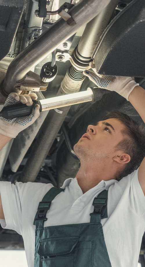 Mechanic working underneath a vehicle